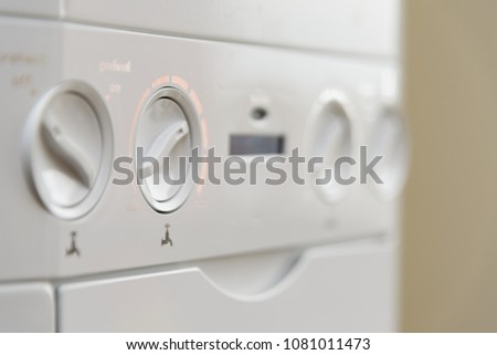 Close up of the controls of a British Combi Gas Boiler