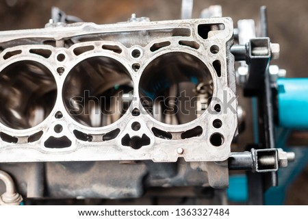 Close-up of the disassembled engine on the stand. New cylinders. Motor capital repair. Sixteen valves and four cylinder. Car service concept. #1363327484