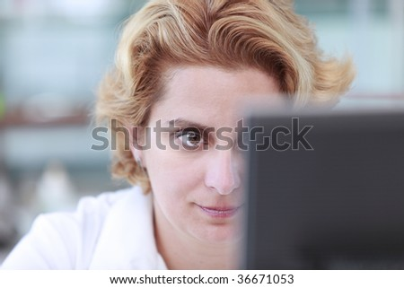 Close up of the eye of a female researcher in front of a computer monitor in a laboratory.