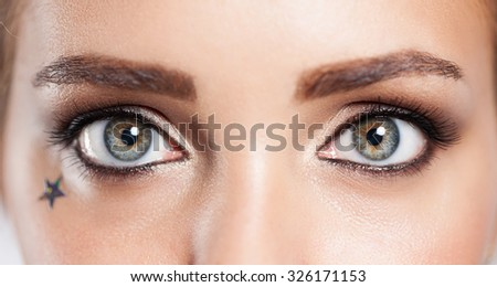 Close up of the eye of a girl with an evening make-up fashion - Shutterstock ID 326171153