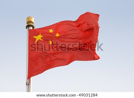 Close-up of the famous Chinese national flag in the heart of Beijing on Tiananmen square - stock photo