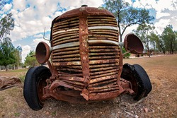 Close up of the front grill of an old rusted truck in the country, fish eye lens