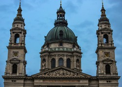 Close-up of the front with its towers and domes of St. Stephen's Basilica at dusk.