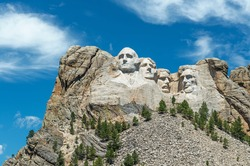Close up of the granite heads of presidents at Mount Rushmore National Monument in the state of South Dakota, United States of America, USA.