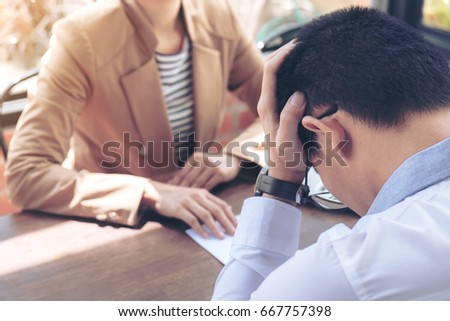 Shutterstock Close up of the hand employer filing final remuneration to employee, Man has stressed, Resignation, resign concept.