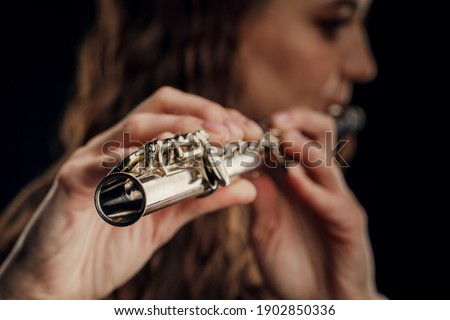 Close-up of the hands of a woman playing the flute. Musical concept ストックフォト ©