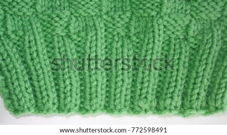 Close up of the knitted Rib Stitch.  Knit two, purl two, knit two, purl two in a pretty green color wool.  Then knitted in a Basket Weave stitch #772598491