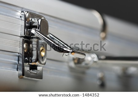 Close up of the lock of a briefcase