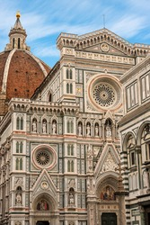 Close-up of the main facade of the Florence Cathedral, Santa Maria del Fiore, with the dome of Brunelleschi and the Baptistery of San Giovanni. UNESCO world heritage site, Tuscany, Italy, Europe.