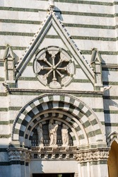 Close-up of the medieval Baptistery of San Giovanni in Corte or Ritondo (1303-1361) in Romanesque style, Piazza del Duomo (Cathedral square). Pistoia, Tuscany, Italy, Europe.