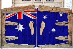 Close-up of the national flag of Australia on a wooden gate at the entrance to the closed territory. The concept of storage of goods, entry to a closed area.