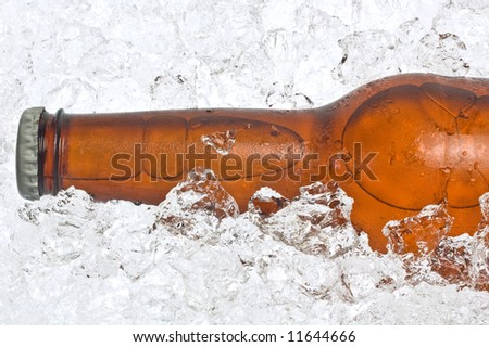 Close-up of the neck of an ice cold beer, resting in crushed ice.