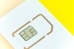 Close-up of the new yellow SIM card of a mobile or cell phone