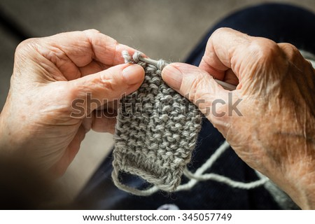 Close up of the old hands knitting. Process of knitting.