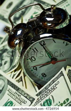 close up of the oldfashioned alarm clock and money
