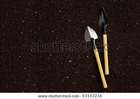 Close-up of the organic soil and spade