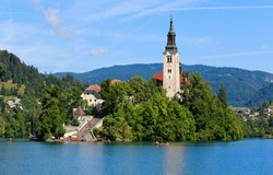 Close-up of the Pilgrimage Church of the Assumption of Maria, located on the iconic Slovenian island on lake Bled. Beautiful sunny day with blue sky.