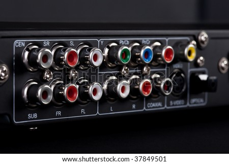Close up of the plugs for the 5.1 surround sound system in a DVD player