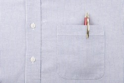 Close Up of the Pocket with Red and Gold Pen and Buttons on a Men's Blue Striped Shirt