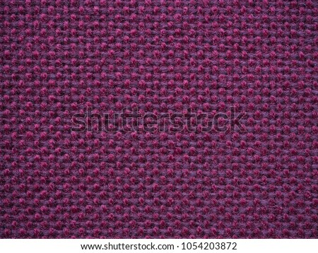 Close-up of the purple textile texture, background and wallpaper. The texture of purple fabric textile upholstery of furniture. High-quality macro photography. #1054203872