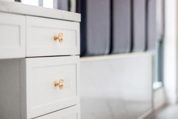 Close-up of the room's white wood cabinets