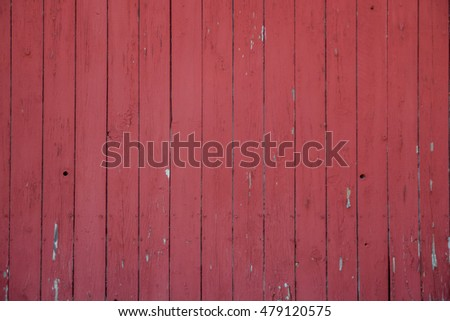 close up of the side of a red barn