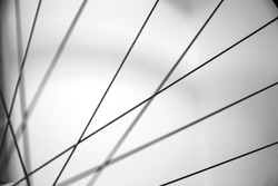Close up of the spokes from a bike wheel. Out of focus abstract of parallel line of bicycle