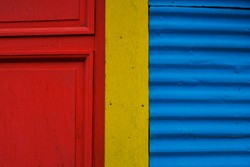 Close up of the street wall pained in red, yellow and blue. Argentina. Buenos Aires. La Boca.