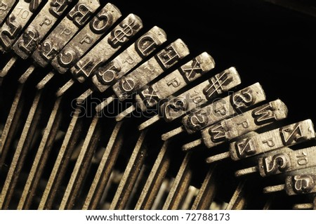 Close-up of the striking surface of old typewriter letter and symbol keys