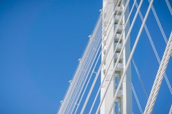 Close up of the suspension cables of the bay bridge going from Oakland to Yerba Buena Island, San Francisco bay, California
