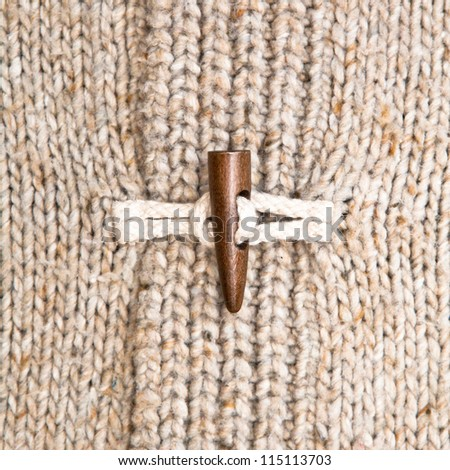 Close up of the toggle on a warm winter jumper