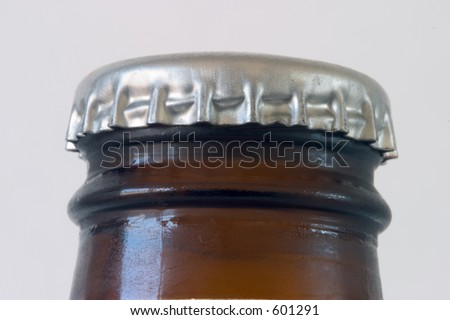Close-up of the top of a beer bottle, unopened.