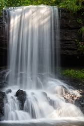 Close-up of the top of scenic Skok waterfall near village Senokos on Balkan mountains, Serbia, casscading down the dark, wet cliff