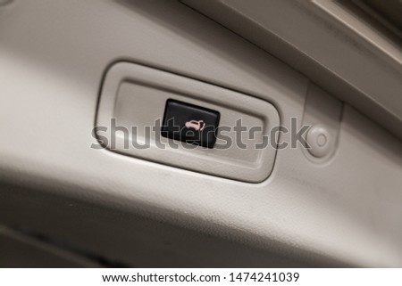Close-up of the trunk release button. modern car interior: parts, buttons, knobs