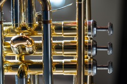 Close up of the valves of a Cornet brass instrument