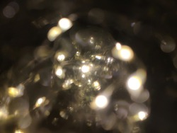 Close-up of the white fairy lights inside a globe. Selective focus points with bokeh effect.