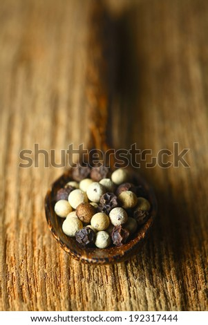 close up of the white pepper and black pepper.