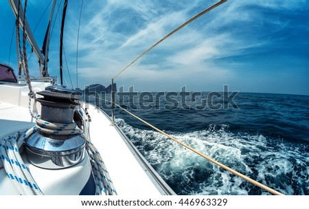 Close up of the winch on the sailing vessel moving in the sea