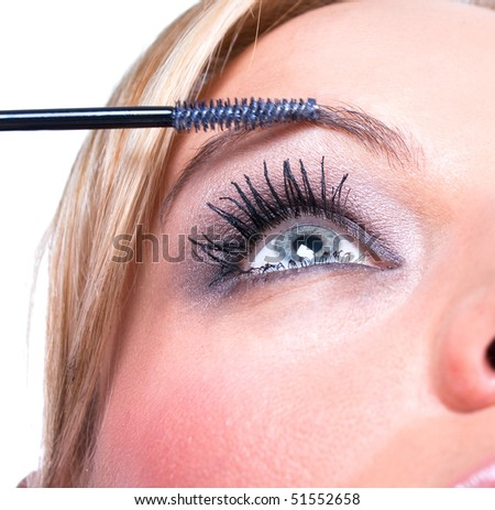 Close up of the woman  paints face with makeup