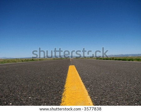 close up of the yellow line on an empty highway