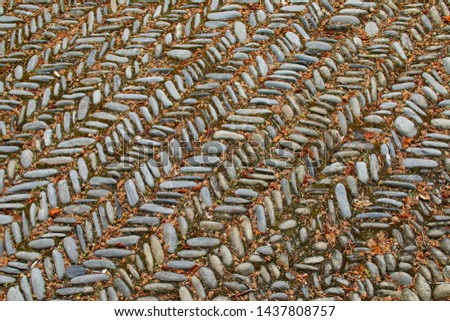 Close up of the zig zag pattern in a cobbled courtyard.  Taken in Wales, UK