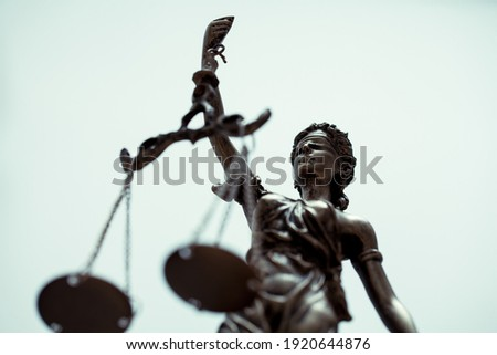 close up of Themis Statue with  Justice Scales on bright background.