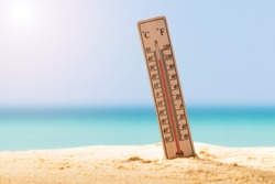 Close-up Of Thermometer On Sand Showing High Temperature