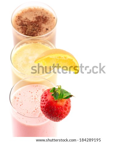 Close-up of three assorted protein cocktails on white background.