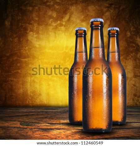Close up of three beer bottles. Cold refreshment