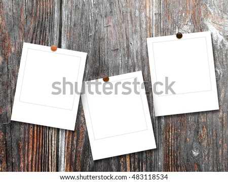 Free Photos Close Up Of Three Square Photo Frames With Pins On Brown