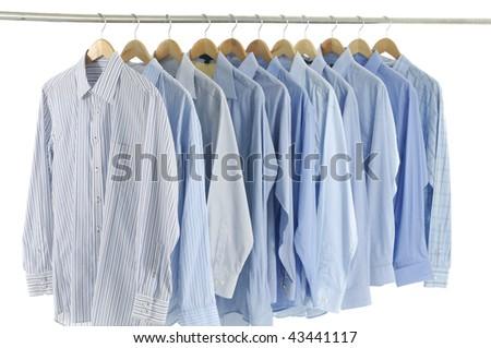 Close up of three blue shirts - stock photo