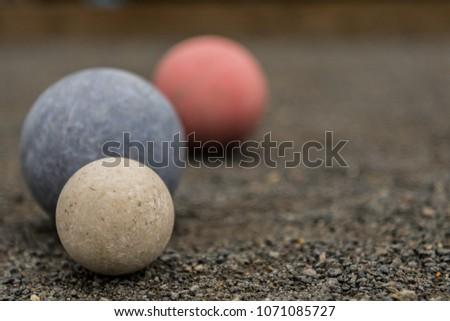 close up of three bocce balls...