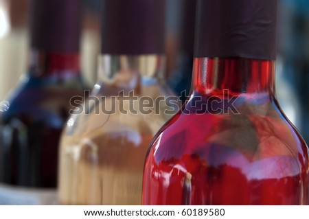 Close-up of three bottles of wine with perspective effect