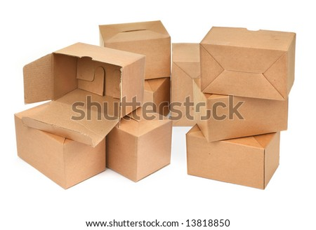 close-up of three cardboard boxes againt white background